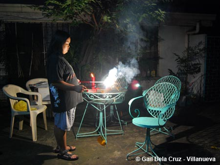 My younger sister lighting New Year lusis sparklers